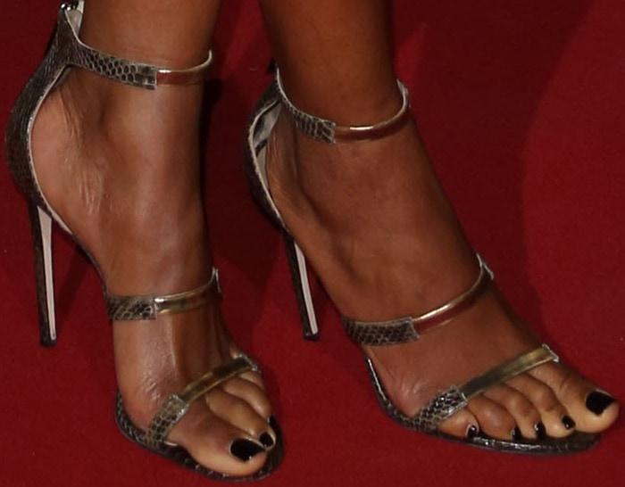 Naomie Harris shows off her feet in triple-strap Tamara Mellon sandals