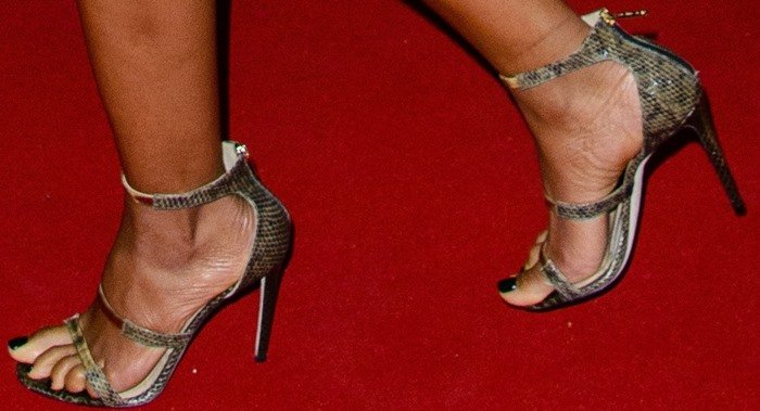 "Naomie Harris struts in a pair of ""Frontline"" sandals"