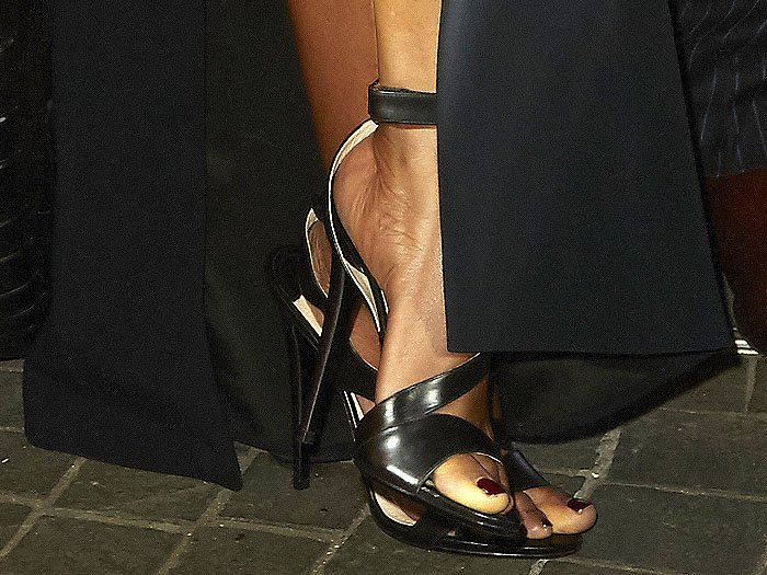 Naomie Harris black leather ankle strap sandals