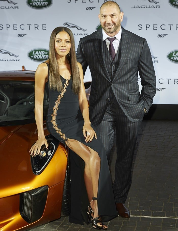 "Dave Bautista and Naomie Harris at the international debut of the Jaguar and Land Rover stunt vehicles used in their upcoming Bond movie ""Spectre"" in Frankfurt on September 15, 2015"