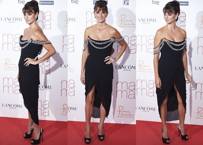 Penelope Cruz poses on the red carpet in a low-cut black Chanel Couture dress