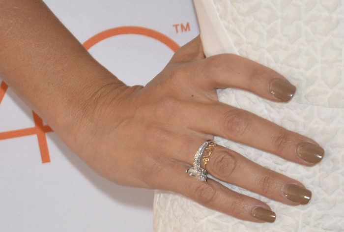 Penelope Cruz showing off her rings and manicure