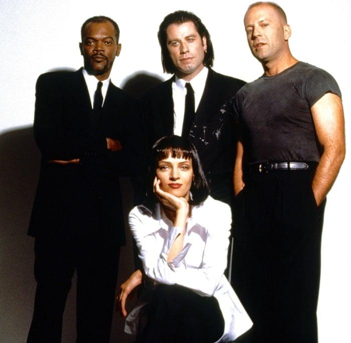 Samuel L. Jackson (as Jules Winnfield), John Travolta (as Vincent Vega), Bruce Willis (as Butch Coolidge), Uma Thurman (seated, as Mia Wallace) in Pulp Fiction (1994)