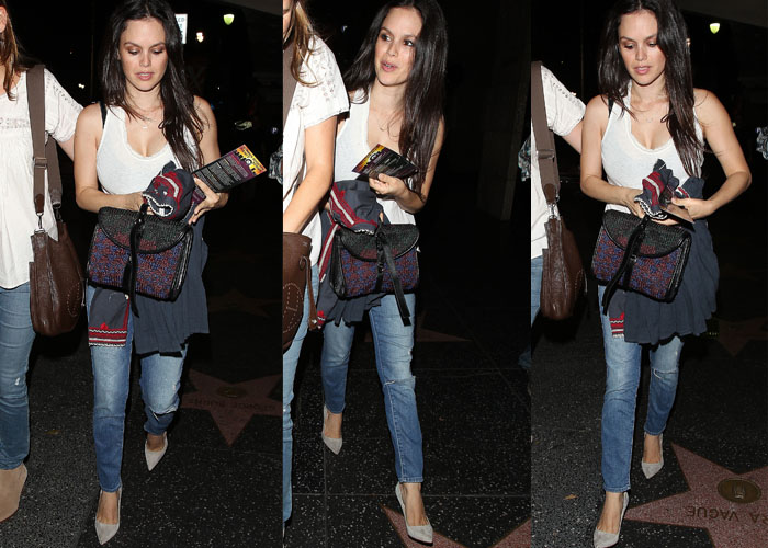 Rachel Bilson styled her jeans with a woven bag and a matching cardigan