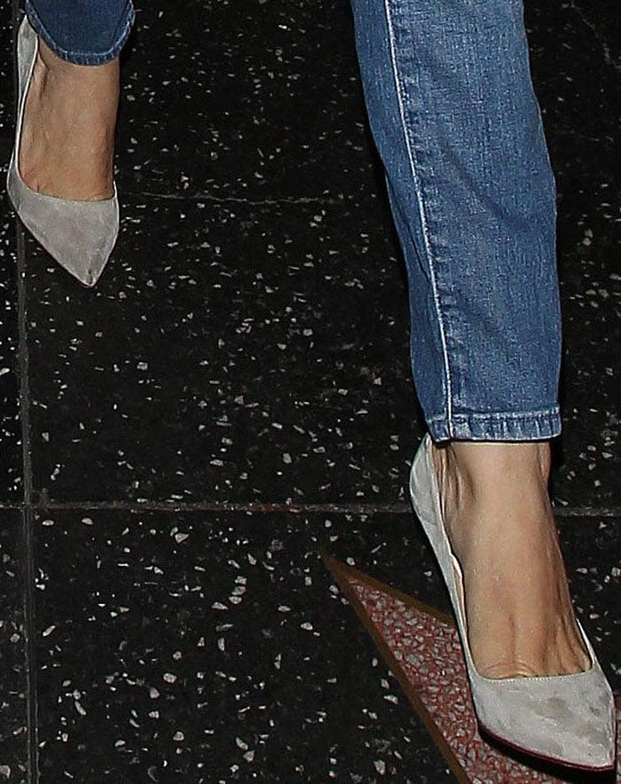 "Rachel Bilson's gray suede Christian Louboutin ""Decollete"" pumps"