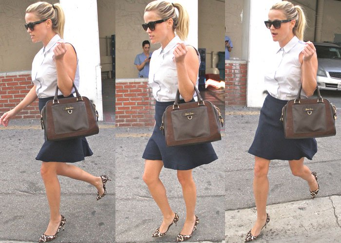 Reese Witherspoon runs errands in a collared top and a navy blue skirt