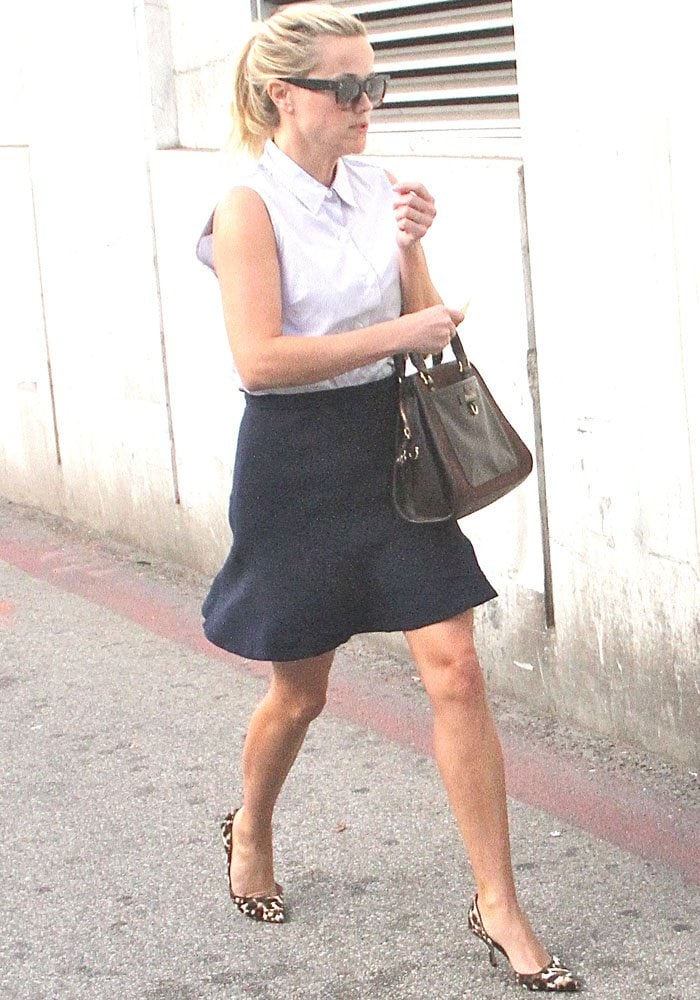 Reese Witherspoon shows off her legs in a polished errand look
