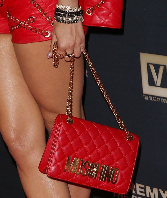 Rita Ora totinga red Moschino chain-strap bag