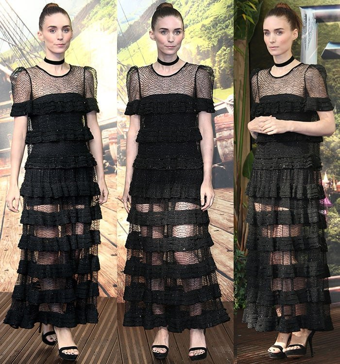 Rooney Mara offers up a smile for the cameras as she shows off her top knot and fresh face of makeup