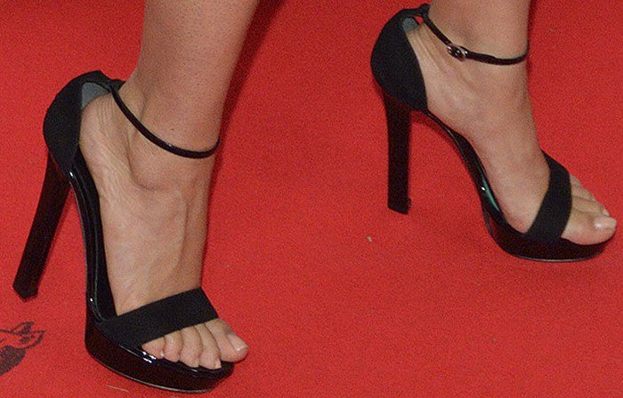 Salma Hayek's heels slide forward in a pair of black heels that seem to be several sizes too large