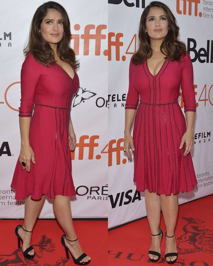 Salma Hayek poses on the red carpet in a red dress from Gucci