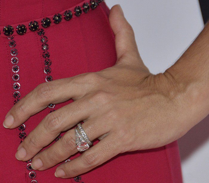 Salma Hayek shows off a silver diamond ring on one hand