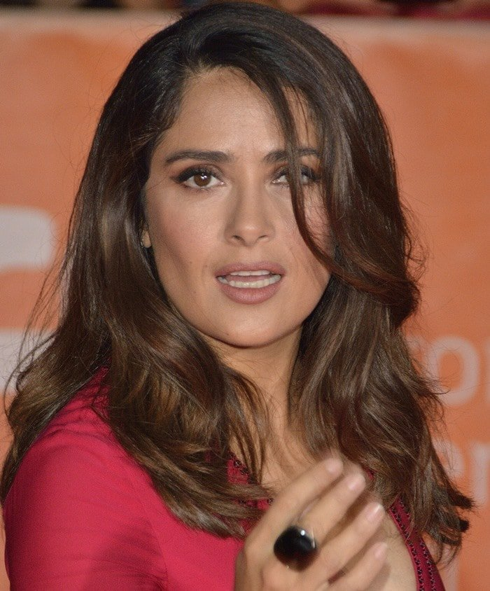 Salma Hayek shows off her smokey eye makeup and onyx ring as she attends the Toronto Film Festival