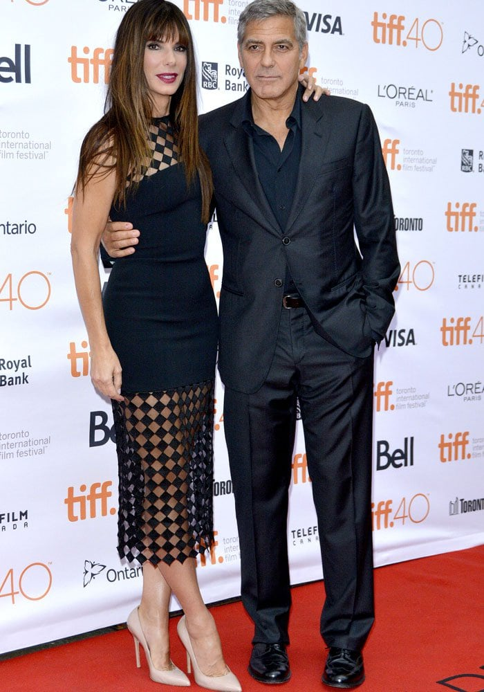 "Sandra Bullock and George Clooney pose together at the Toronto premiere of their film ""Our Brand is Crisis"""