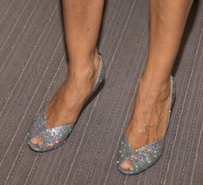 Sarah Jessica Parker shows off her feet in Naomi pumps from her own collection