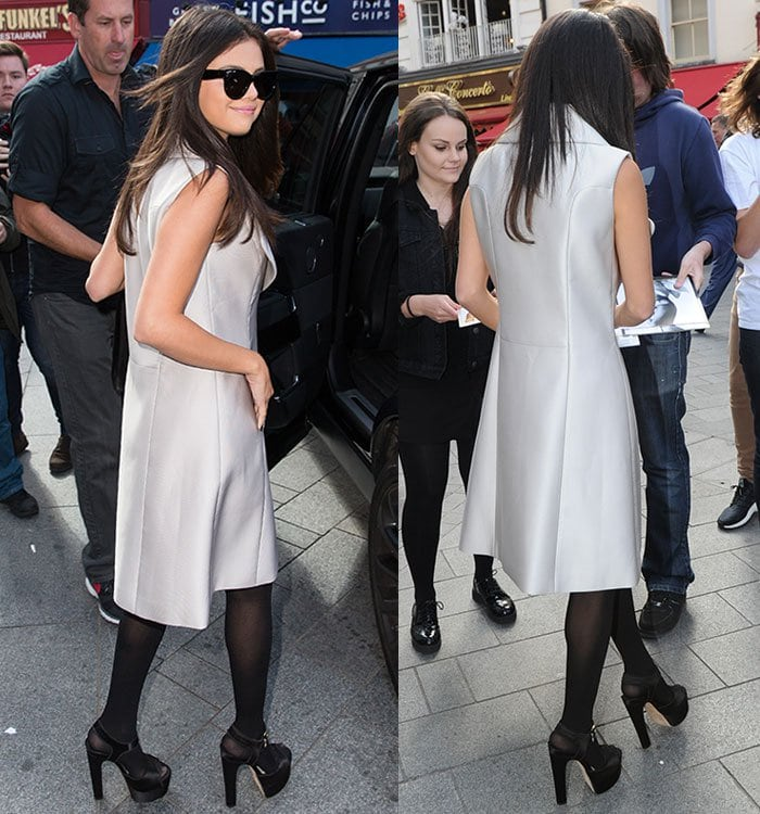 Selena Gomez smiles for the cameras in an ivory coatdress from Co Resort