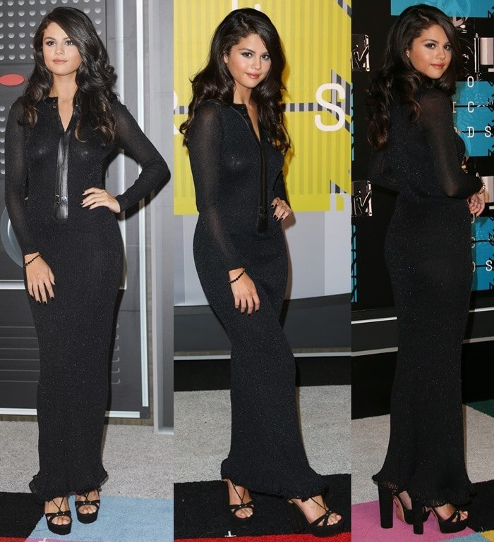 Selena Gomez poses in her ultra-conservative head-to-toe black look