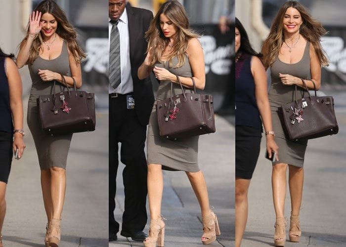 Sofia Vergara carries an Hermes tote and waves to the cameras she arrives at ABC Studios in Los Angeles