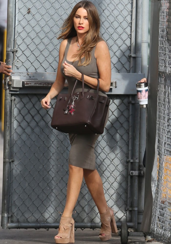 Sofia Vergara pairs a knit dress with some suede Aquazzura platforms for a television appearance