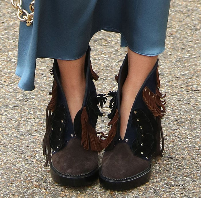 """Suki Waterhouse shows off the fringe detailing on her """"Lilybell"""" booties"""