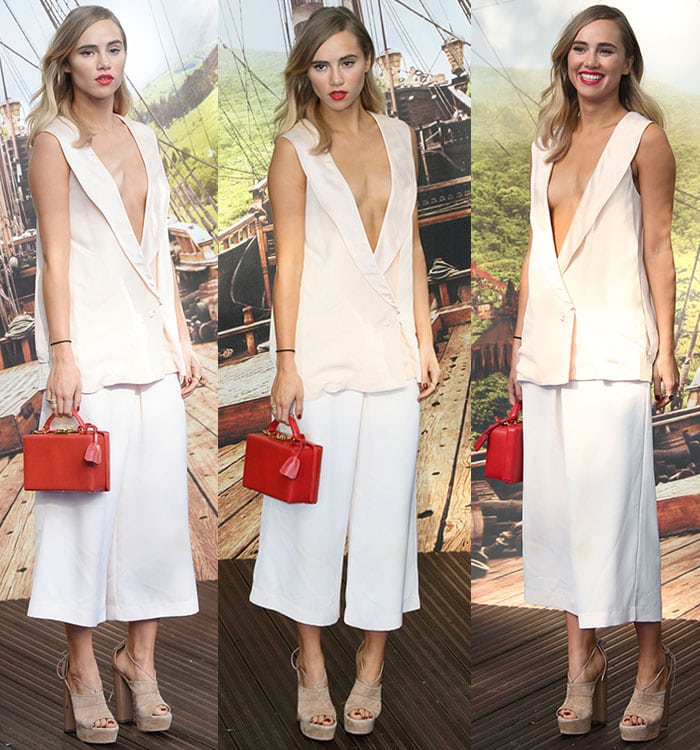 Suki Waterhouse shows off a lot of cleavage and red lipstick in a Camilla and Marc ensemble