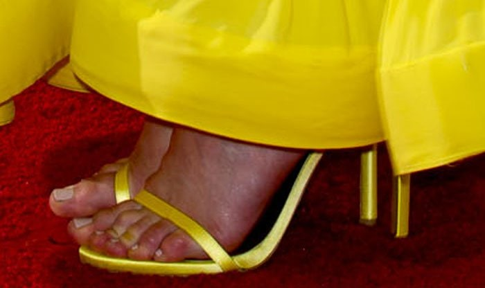 Taylor Schilling's feet peek out from a pair of Stuart Weitzman sandals
