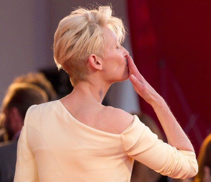 Tilda Swinton blows a kiss from the carpet at the premiere of her new film