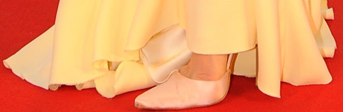 Tilda Swinton finishes off her red carpet look with a pair of white pumps