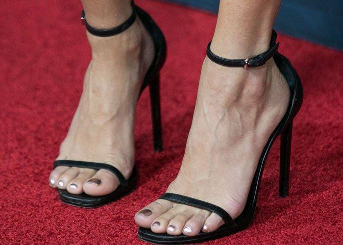 Vanessa Hudgens shows off a metallic pedicure in a simple pair of Saint Laurent heels
