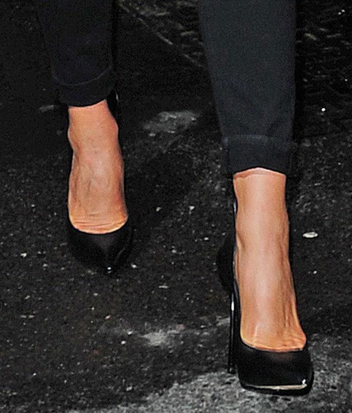 Victoria Beckham's feet show in a pair of Casadei pumps