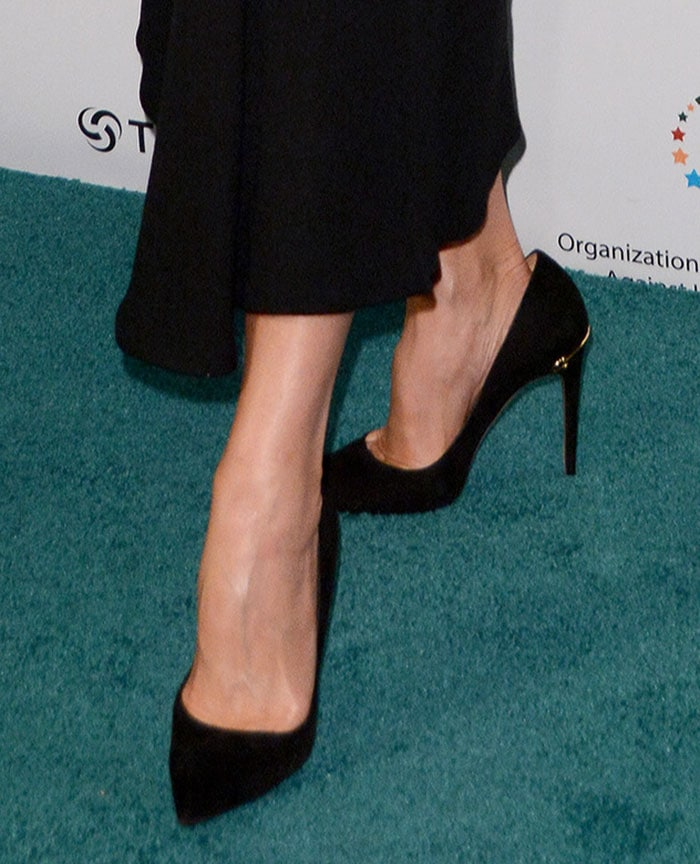Victoria Beckham wears a pair of Gucci pumps that appear to be a size too big for her feet