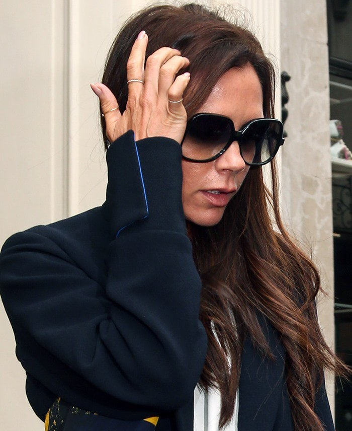 Victoria Beckham refusing to smile while leaving her London shop