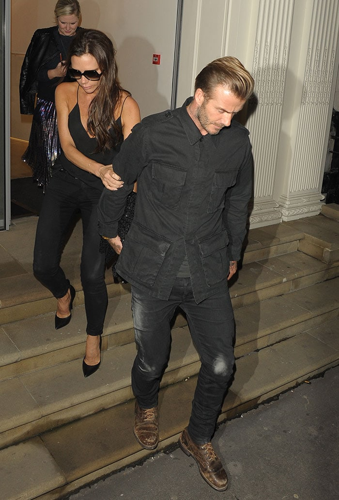 Victoria Beckham's dark hair tumbles down her shoulders as she exits her Dover Street store