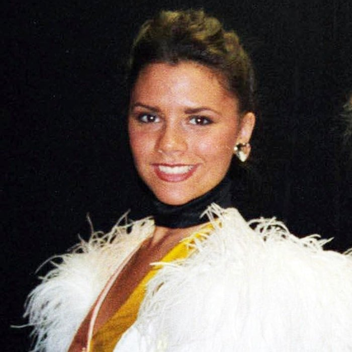 Victoria Beckham smiling in her first stage role, the 1993 production of Bertie