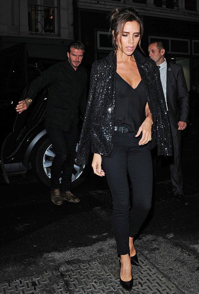 Victoria Beckham leaves her boutique with husband David Beckham