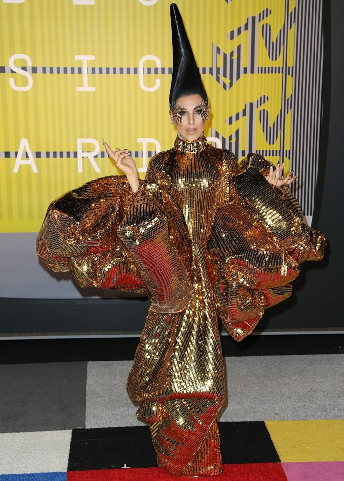 Z LaLa did not fail to turn heads in an impressive gold Christian Dior by John Galliano Spring 2004 Couture gown featuring giant, billow sleeves