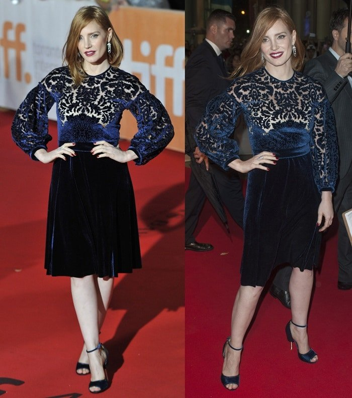 Jessica Chastain poses with her hands on her hips at the Toronto International Film Festival