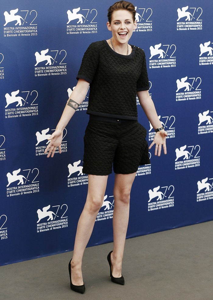 Kristen Stewart posed for the cameras in a custom-made black quilted top with matching shorts, finishing the look with black suede Jimmy Choo 'Kayomi' pumps