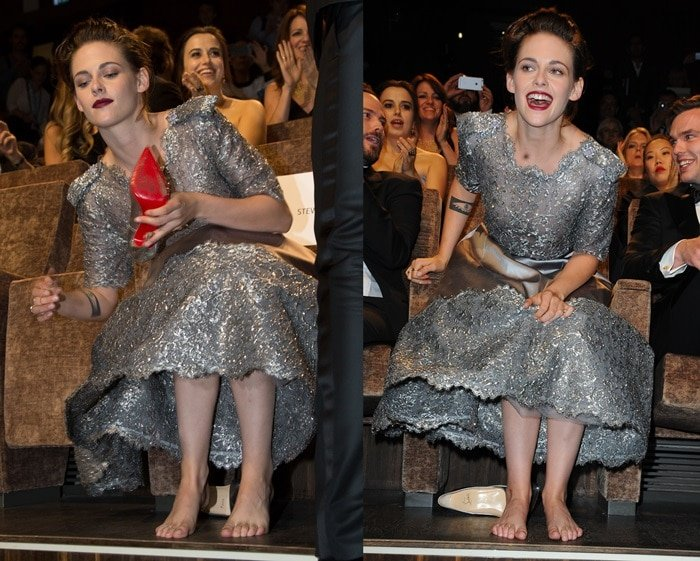 Kristen Stewart slips off her Louboutin pumps after posing on the red carpet with her co-star, Nicholas Hoult