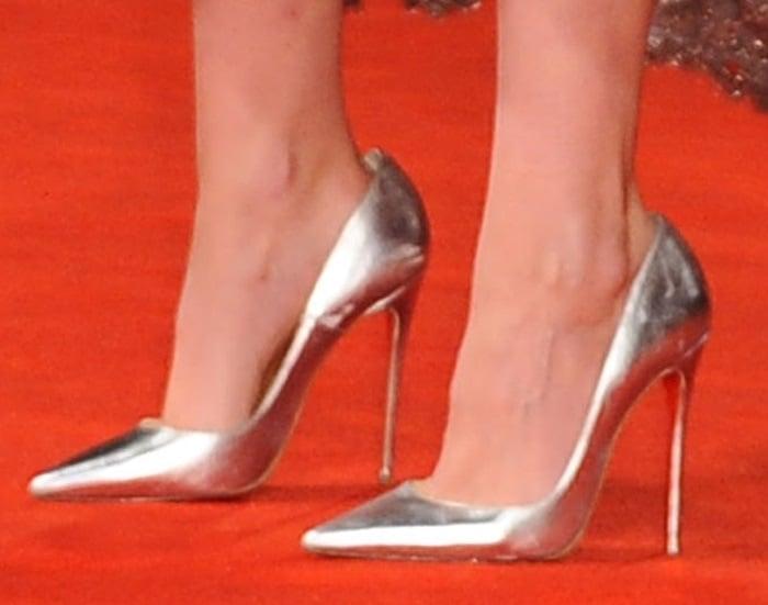 Kristen Stewart wearing metallic silver Christian Louboutin So Kate pumps