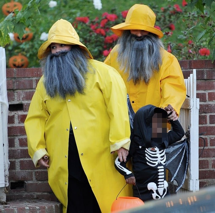 Wearing bright yellow raincoat costumes with manly long beards, Sandra Bullock went trick or treating with good friend Melissa McCarthy and Sandra's son Louis Bardo Bullock in a skeleton costume