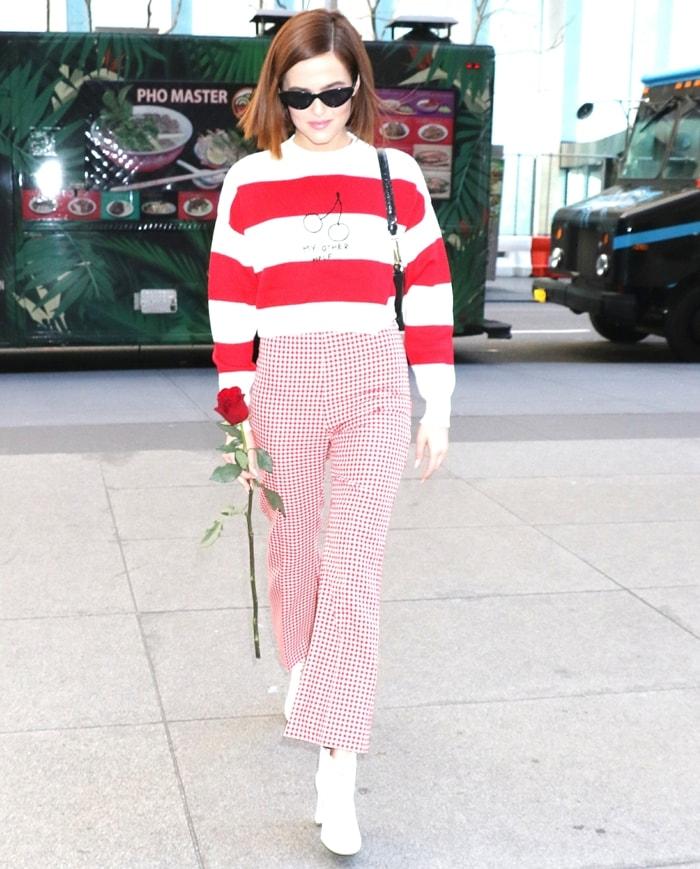 Actress Zoey Deutch visits the SiriusXM Studios in a cherries striped jumper from Miu Miu