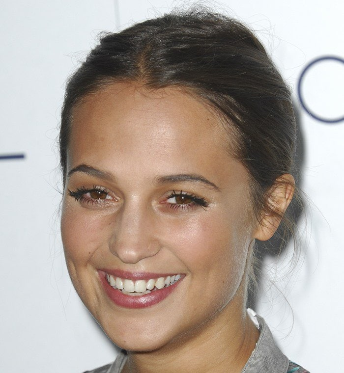 Alicia Vikander wears her hair back at the 2015 Elle Women in Hollywood Awards