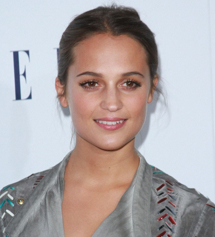 Alicia Vikander wears a Louis Vuitton mini dress at the Elle Women in Hollywood Awards