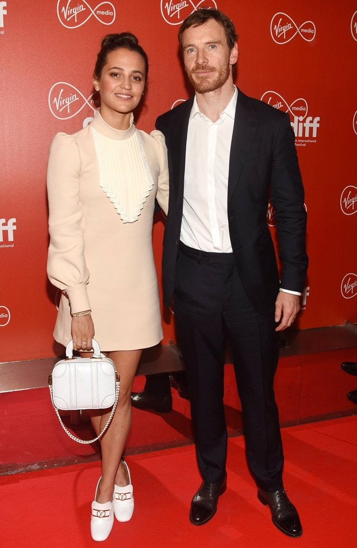Michael Fassbender, who has a net worth of $30 million, with his wife Alicia Vikander