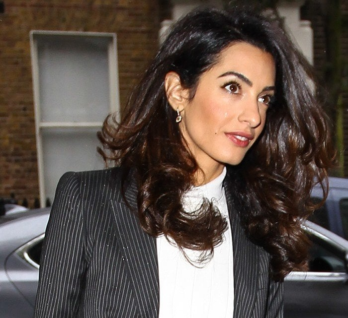 Amal Clooney wears her hair down as she heads to a press conference in London