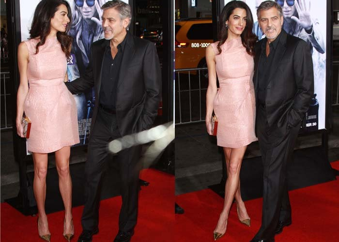 """Amal Clooney and George Clooney pose for photos on the red carpet of """"Our Brand is Crisis"""""""