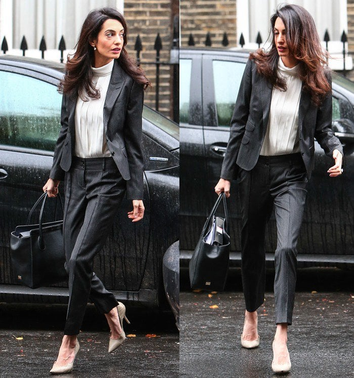 Amal Clooney wears a Dolce & Gabbana suit as she heads to a press conference