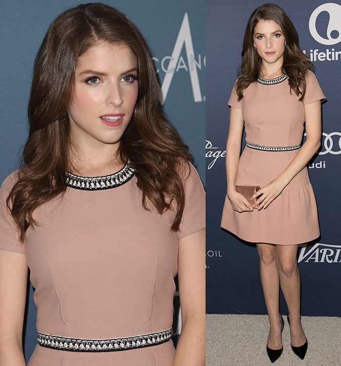 Anna Kendrick wears her hair in loose curls and sports shimmery eye makeup at a Variety luncheon