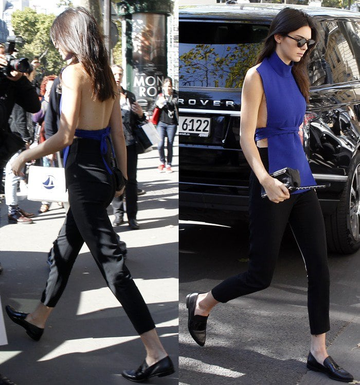Kendall Jenner's dark hair trails down her back as she strolls through Paris in Camilla and Mark Honour slip-ons